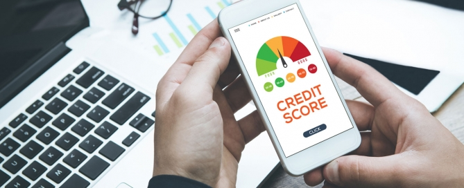 Close up of person checking their credit score on mobile phone